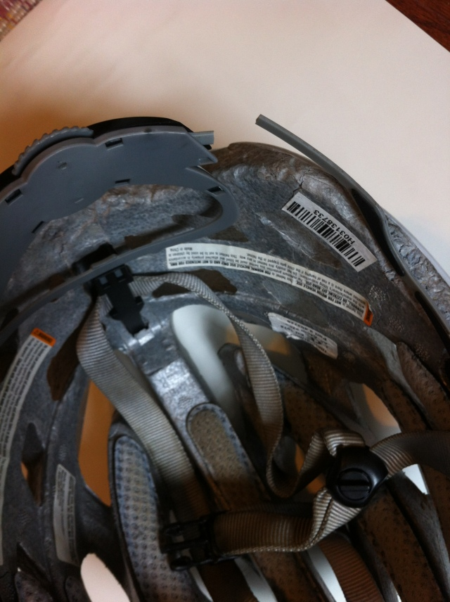 Broken adjustment strap on a bicycle helmet